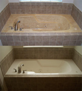Cultured marble tub set in tile after refinishing.